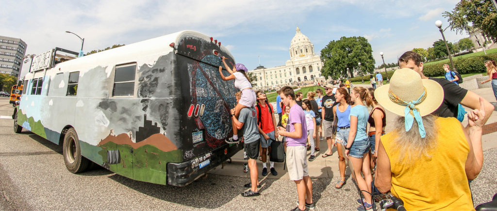Youth Climate Stikers Sign Stop Line 3 School Bus at Saint Paul Capitol